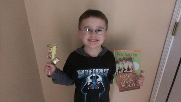 Here again is Collin with the Spongebob mallow pop and See's butterscotch lollypop that I gave him along with the books. Photo taken by his mom, Daniel's cousin, Chelsie.
