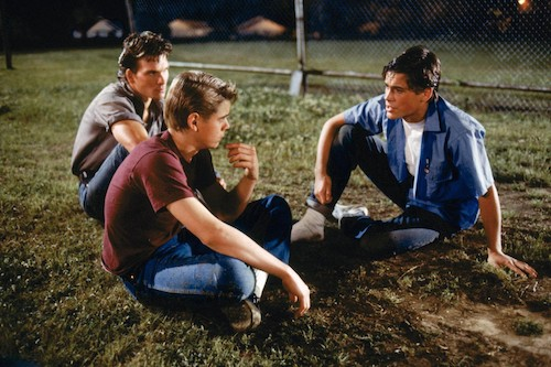 The Curtis Brothers: Patrick Swayze as Darrel, C Thomas Howell as Ponyboy, and Rob Lowe as the handsome Sodapop.