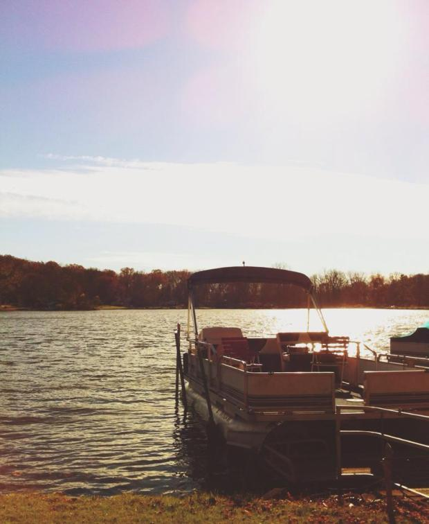 This boat is owned by my boyfriend's parents, and it sits quietly on a dock at O'Dell's Lake in Ohio.