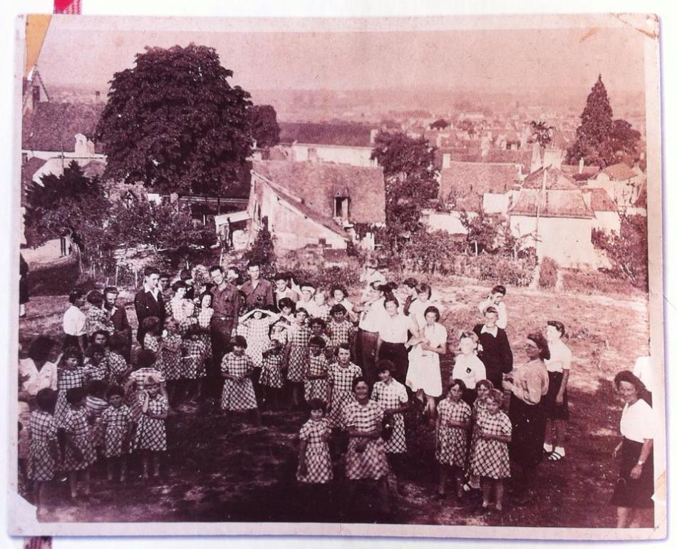 This was a group photo of the orphans taken in Vaureal, France. They are wearing their red-white-and-blue tattersall dresses.