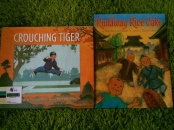 http://gatheringbooks.org/2015/05/18/monday-reading-ying-chang-compestines-picturebooks-crouching-tiger-and-the-runaway-rice-cake/