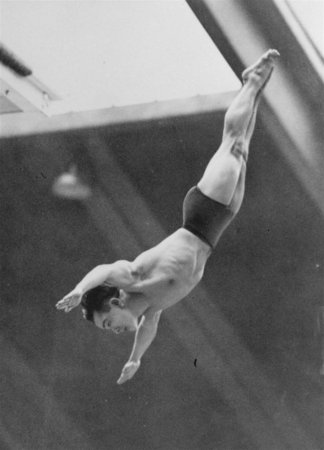 Dr. Sammy Lee, U.S. Army Medical Lieutenant from Pasadena, Calif., dives from the tower of the Empire Pool in Wembley, England, August 5, 1948 in the Olympic Tower Diving Championships.  Lee, after winning championship, announced he would retire form sport to devote his time to medicine.  (AP Photo) NYTCREDIT: Associated Press