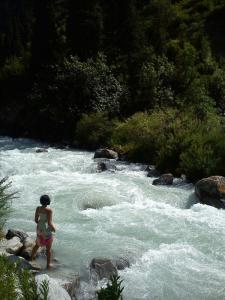 Anita checking out the flowing waters in Kyrgyzstan